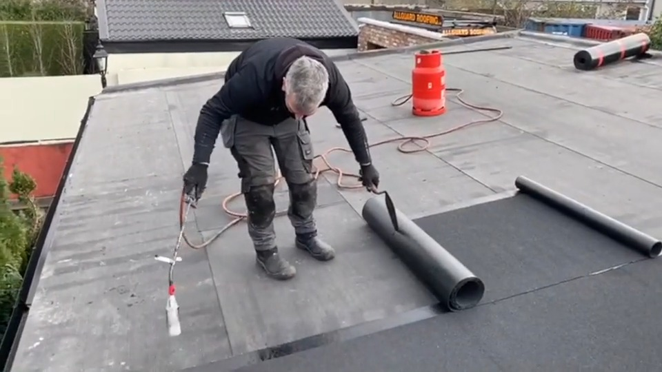 flat roof being repaired by roofers.ie